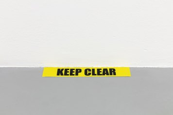FLO-006 - Ceal Floyer - KEEP CLEAR, 2021 - Inline printed floor marking tape, empty wall - Variable dimensions - Edition 1/4 + II AP